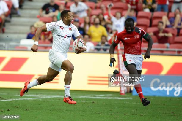 Dan Norton of England runs the ball and scores a try during the 2018 Singapore Sevens Pool B match between Kenya and England at National Stadium on...