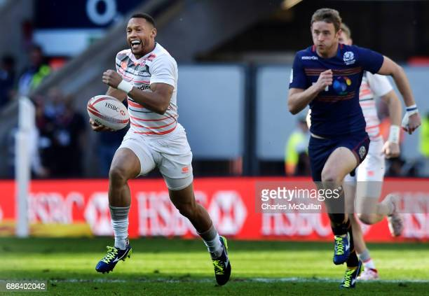 Dan Norton of England runs through the Scotland back line during the HSBC London Sevens cup final at Twickenham Stadium on May 21 2017 in London...