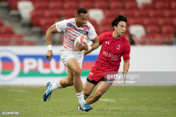 Dan Norton of England runs with the ball while Nathan Hirayama of Canada tries to stop him during the match Canada vs England Day 2 of the HSBC...
