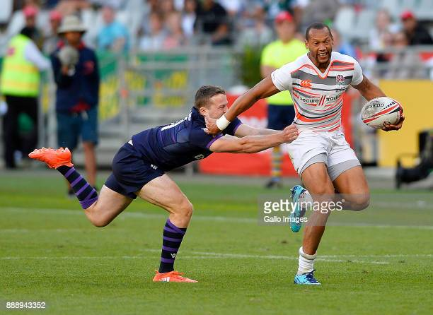 Dan Norton of England tackled by Max McFarland of Scotland during day 1 of the 2017 HSBC Cape Town Sevens match between England and Scotland at Cape...