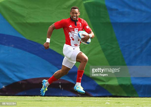 Dan Norton of Great Britain breaks through as he scores a try during the Men's Rugby Sevens Pool C match between Great Britain and Kenya on Day 4 of...
