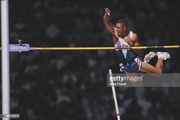 Dan O'Brien of the United States clears the bar during the pole vault event of the Men's Decathlon at the 4th IAAF World Championships in Athletics...