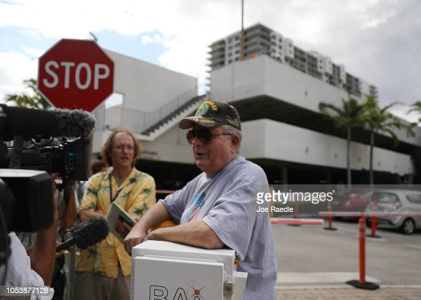 Dan Ochsenshlager speaks to the media at the front gate to the condo building that has a possible connection to alleged bomber Cesar Sayoc and his...