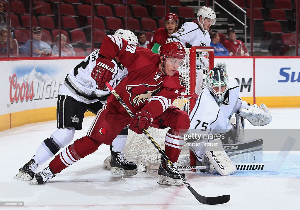 Dan O'Donoghue #78 of the Arizona Coyotes attempts a wrap around shot on goaltender Brandon Maxwell #75 of the Los Angeles Kings during the NHL rookie camp game at Gila River Arena on September 16, 2014 in Glendale, Arizona.