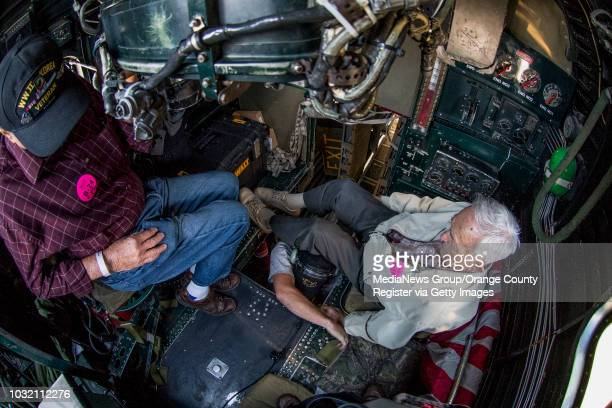Dan Oldewage left and Buhl Palmer sit behind the cockpit of a B24 Liberator while they fly over Orange County on Friday May 12 2017 Palmer was a...
