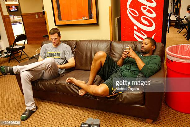 Dan Otero and Alberto Callaspo of the Oakland Athletics relax in the clubhouse prior to the game against the San Francisco Giants at ATT Park on July...