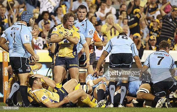 Dan Palmer of the Brumbies celebrates a try by Ben Mowen during the round four Super Rugby match between the Brumbies and the Waratahs at Canberra...