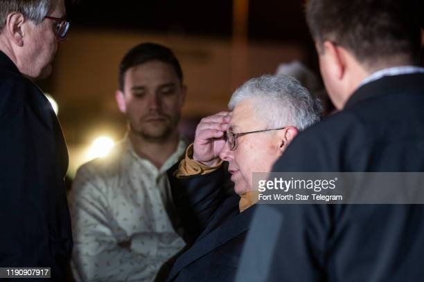 Dan Patrick lieutenant governor of Texas talks with Senior Minister Britt Farmer at the scene of a shooting Sunday Dec 29 at West Freeway Church of...