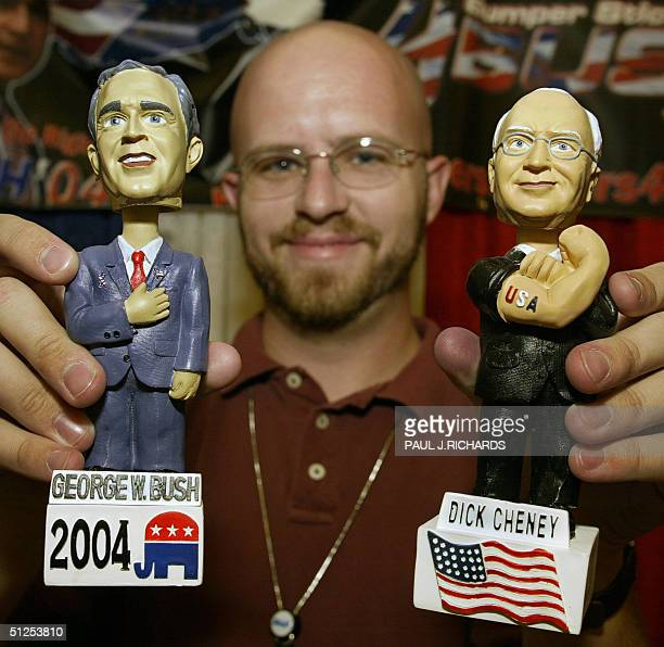 Dan Phoenix of Glendale Arizona holds up bobblehead dolls of US President George W Bush and Vice President Dick Cheney he sells for 15 USD each in...
