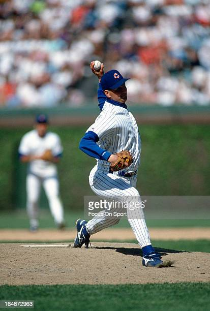 Dan Plesac of the Chicago Cubs pitches during an Major League Baseball game circa 1993 at Wrigley Field in Chicago Illinois Plesac played for the...