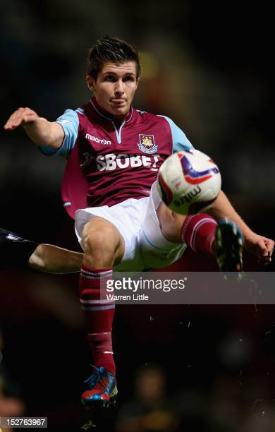 Dan Pott of West Ham jumps for the ball during the Capital One Cup Third Round match between West Ham and Wigan Athletic on September 25 2012 in...