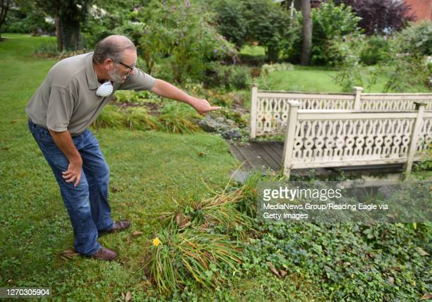 Dan Pottiger, the Lower Alsace Township Manager points out flood damage to a small bridge over a stream behind a house along Park Lane. In Lower...
