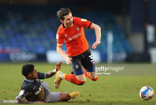 Dan Potts of Luton battles with Kadeem Harris of Sheffield Wednesday during the Sky Bet Championship match between Luton Town and Sheffield Wednesday...
