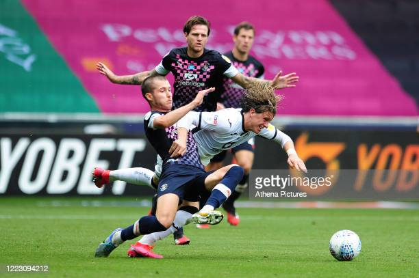 Dan Potts of Luton Town battles with Conor Gallagher of Swansea City during the Sky Bet Championship match between Swansea City and Luton Town at the...