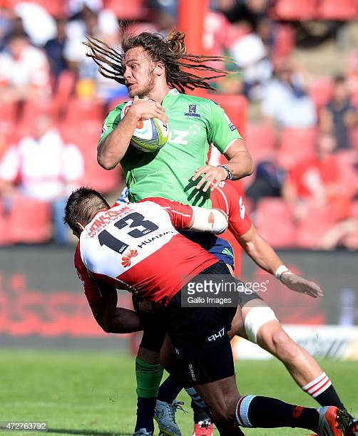 Dan Pryor of the Highlanders gets tackled by Harold Vorster during the Super Rugby match between Emirates Lions and Highlanders at Emirates Airline...