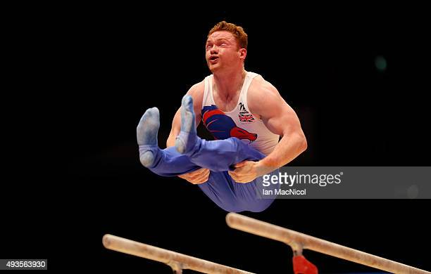 Dan Purvis of Great Britain practises on the parallel bars during the 2015 World Artistic Gymnastics Championships Media Session at The SSE Hydro on...