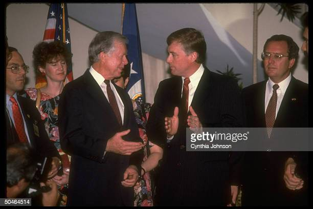 VP Dan Quayle chatting up former Pres Jimmy Carter attending inauguration of Pres Carlos Andres Perez