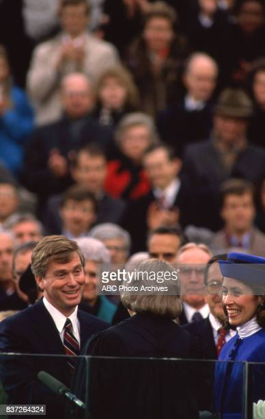 Dan Quayle is sworn into office Wife Marilyn Quayle looks on