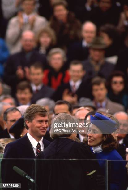 Dan Quayle kisses wife Marilyn Quayle after beign sworn into office