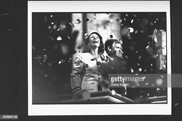 Dan Quayle waving to crowd as his wife Marilyn beams amidst blizzard of confetti after making speech at the Republican National Convention in the...
