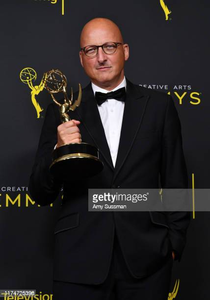 Dan Reed poses with the Outstanding Documentary or Nonfiction Special Award for 'Leaving Neverland' in the press room during the 2019 Creative Arts...