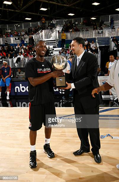 Dan Reed President of the NBA DLeague congratulates Andre Ingram of the Utah Flash on winning the 3Point Compettition as part of the NBA DLeague...