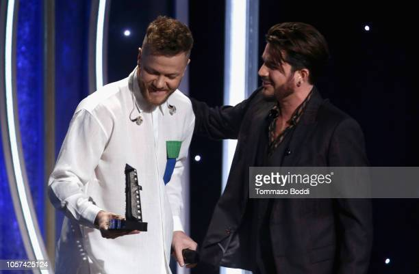 Dan Reynolds accepts the Hollywood Documentary Award for 'Believer' from Adam Lambert onstage during the 22nd Annual Hollywood Film Awards at The...