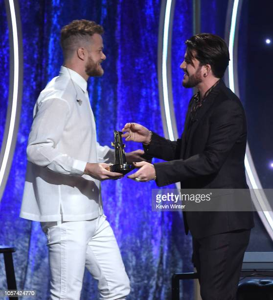 Dan Reynolds accepts the Hollywood Documentary Award from Adam Lambert onstage during the 22nd Annual Hollywood Film Awards at The Beverly Hilton...