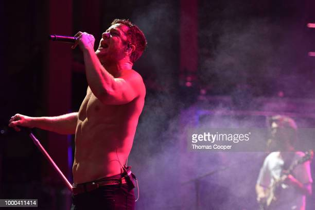 Dan Reynolds and Wayne Sermon of Imagine Dragons perform during their Evolve World Tour stop at Red Rocks Amphitheatre on July 16 2018 in Morrison...