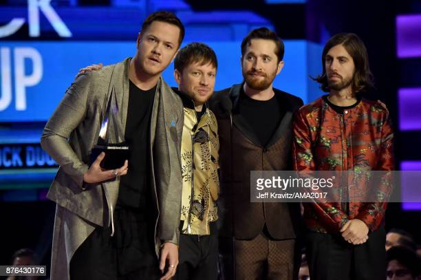 Dan Reynolds Ben McKee Daniel Platzman and Daniel Wayne Sermon of Imagine Dragons on stage at the 2017 American Music Awards at Microsoft Theater on...