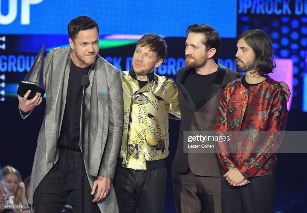Dan Reynolds, Ben McKee, Daniel Platzman and Daniel Wayne Sermon of Imagine Dragons accepts award for Favorite Duo or Group - Pop/Rock onstage during the 2017 American Music Awards at Microsoft Theater on November 19, 2017 in Los Angeles, California.