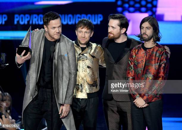 Dan Reynolds Ben McKee Daniel Platzman and Wayne Sermon of music group Imagine Dragons accept the Favorite Duo or Group Pop/Rock award onstage during...