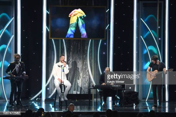 Dan Reynolds Hans Zimmer and Tim Edgar perform onstage during the 22nd Annual Hollywood Film Awards at The Beverly Hilton Hotel on November 4 2018 in...