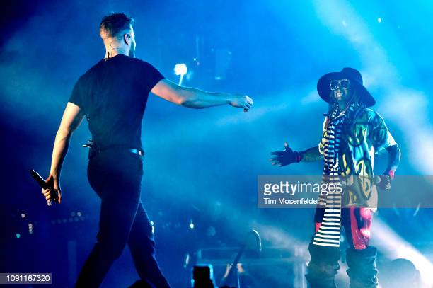Dan Reynolds of Imagine Dragons and Lil Wayne perform during the 2019 ESPN College Football Playoff halftime performance at Treasure Island on...