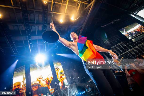 Dan Reynolds of Imagine Dragons holds a gay pride flag during their Evolve World Tour 2018 at DTE Energy Music Theater on June 21 2018 in Clarkston...
