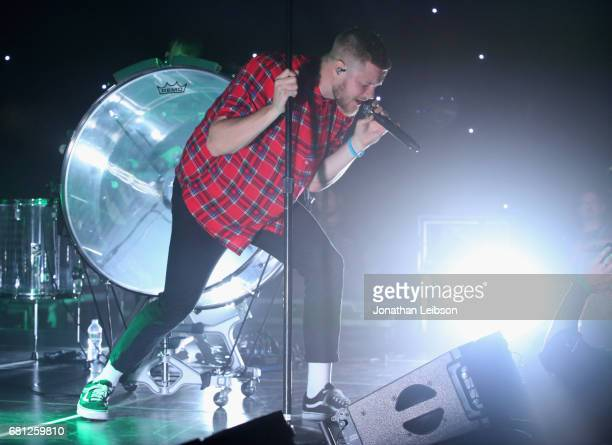 Dan Reynolds of Imagine Dragons performs at the Evolve Tour and Album Live Stream Event at YouTube Space LA on May 9 2017 in Los Angeles California