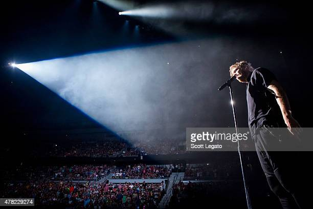 Dan Reynolds of Imagine Dragons performs during the Smoke + Mirros Tour on June 23, 2015 in Auburn Hills, Michigan.