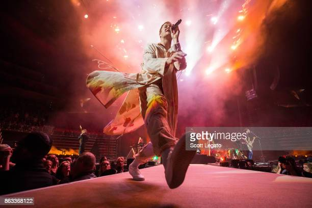 Dan Reynolds of Imagine Dragons performs during their Evolve World Tour at Little Caesars Arena on October 19 2017 in Detroit Michigan