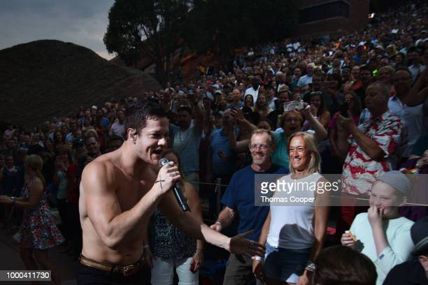 Dan Reynolds of Imagine Dragons performs in a sold out crowd during their Evolve World Tour stop at Red Rocks Amphitheatre on July 16 2018 in...