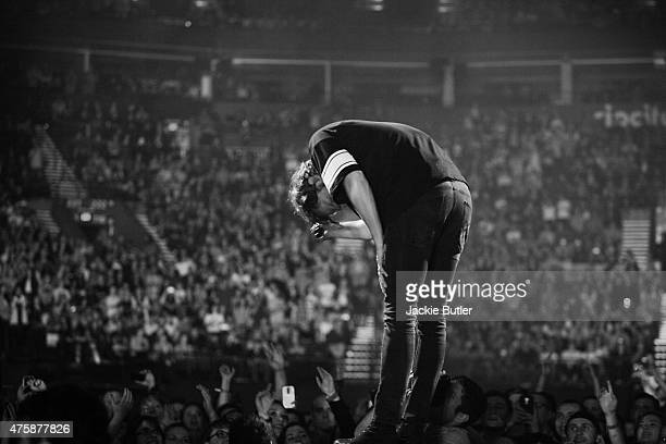 Dan Reynolds of Imagine Dragons performs on stage at Moda Center on June 3 2015 in Portland Oregon