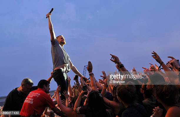 Dan Reynolds of Imagine Dragons performs on stage during Day 2 of the Reading Festival at Richfield Avenue on August 27, 2016 in Reading, England.