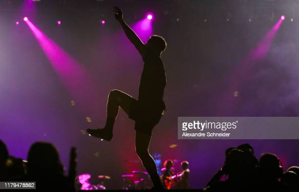 Dan Reynolds of Imagine Dragons performs on stage during Rock in Rio 2019 Day 7 at Cidade do Rock on October 06 2019 in Rio de Janeiro Brazil