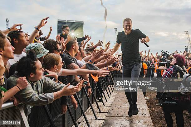 Dan Reynolds of Imagine Dragons performs on the Main Stage during day 3 of Leeds Festival 2016 at Bramham Park on August 28 2016 in Leeds England
