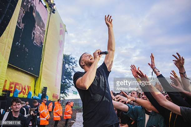 Dan Reynolds of Imagine Dragons performs on the Main Stage during day 3 of Leeds Festival 2016 at Bramham Park on August 28, 2016 in Leeds, England.