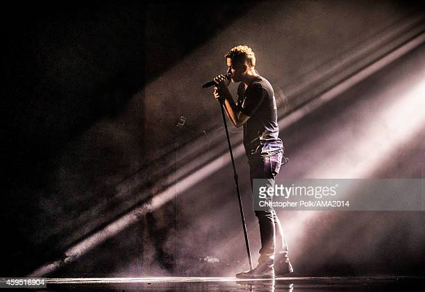 Dan Reynolds of Imagine Dragons performs onstage at the 2014 American Music Awards at Nokia Theatre LA Live on November 23 2014 in Los Angeles...