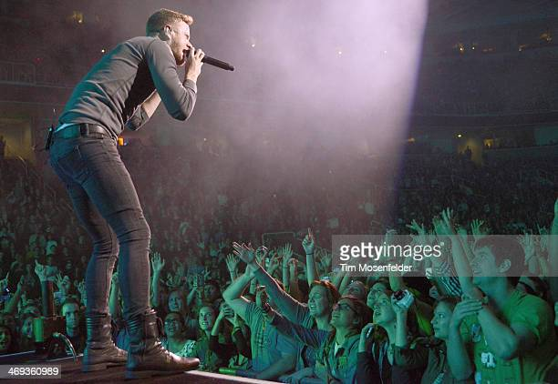 Dan Reynolds of Imagine Dragons performs part of the bands' 'Into The Night Tour' at SAP Center on February 13 2014 in San Jose California
