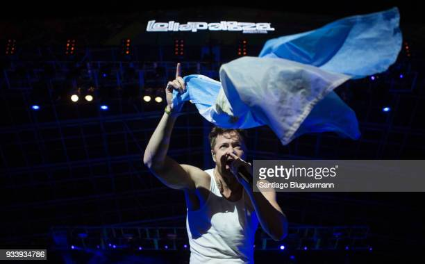 Dan Reynolds of Imagine Dragons waves the flag of Argentina during the first day of Lollapalooza Buenos Aires 2018 at Hipodromo de San Isidro on...