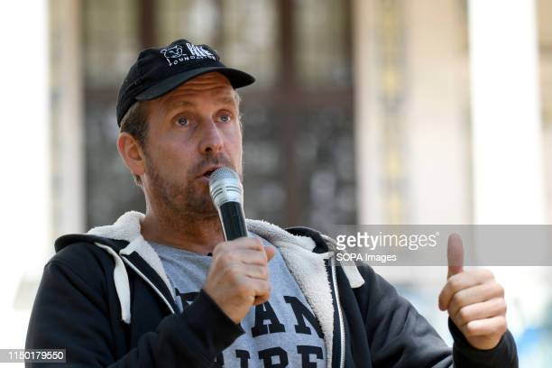 Dan Richardson speaks during the march Animal rights activists marched through central London to demand the closing of the slaughterhouses and to...