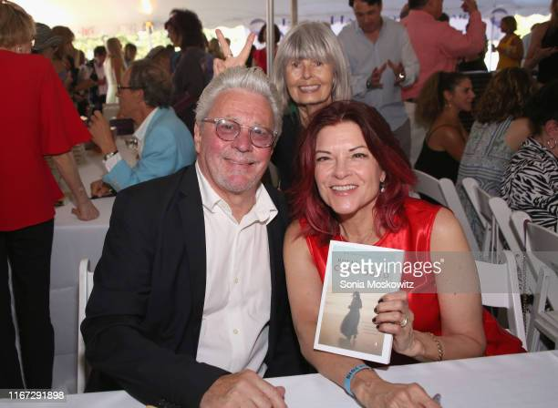 Dan Rizzie and Rosanne Cash at the East Hampton Library's 15th Annual Authors Night Benefit on August 10, 2019 in Amagansett, New York.