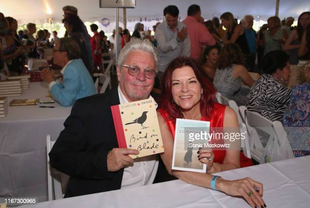 Dan Rizzie and Rosanne Cash at the East Hampton Library's 15th Annual Authors Night Benefit on August 10 2019 in Amagansett New York